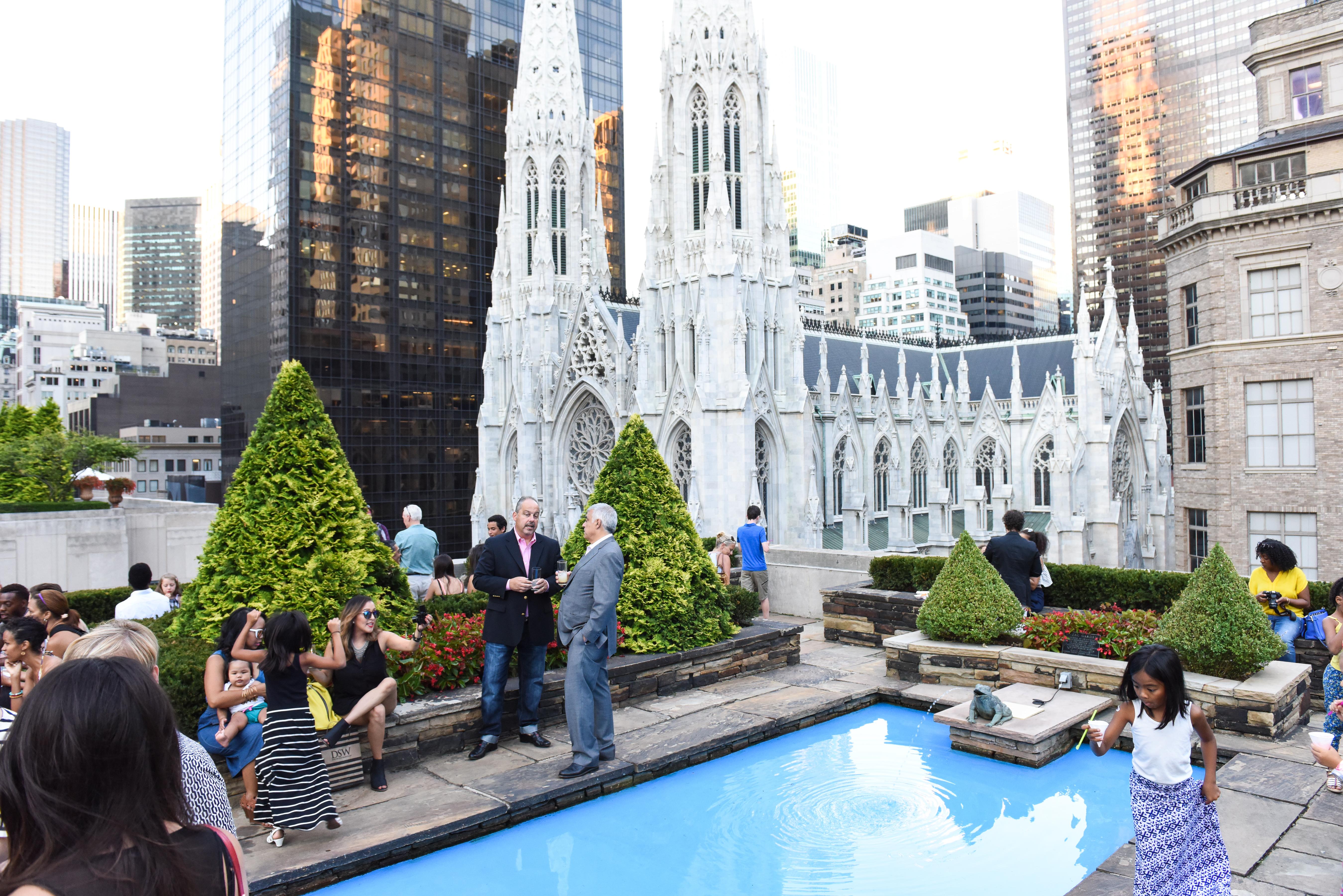 Guests mingling in the Rockefeller rooftop garden.