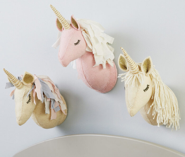 Hand-crafted boiled-wool unicorn wall mounts with yarn and rope fringe manes will have little ones  dreaming in glitter.