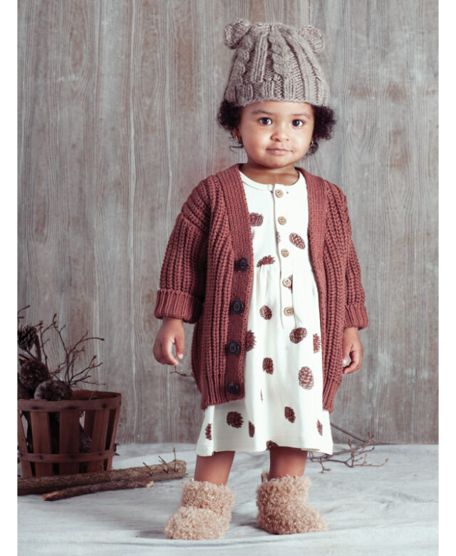 Sevyn wears Huxbaby cardigan, City Mouse dress, Blueberry Hill bear hat and boots by Bearpaw.