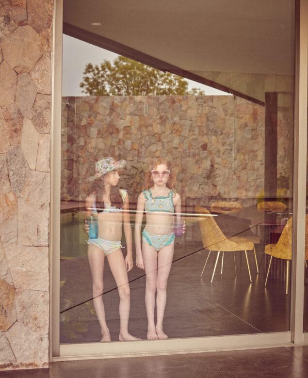 From left: Carlotta is wearing swimwear by Limeapple,  hat by Olga Valentine. Léo is wearing swimwear by Verrone, sunglasses by Lola and the Boys.