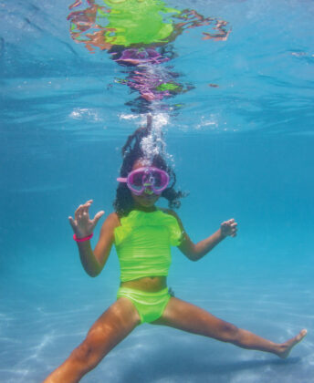 Opposite: Sophie wears Planet Sea neon two-piece,   goggles by Bling2O and bracelet by Henny and Coco.