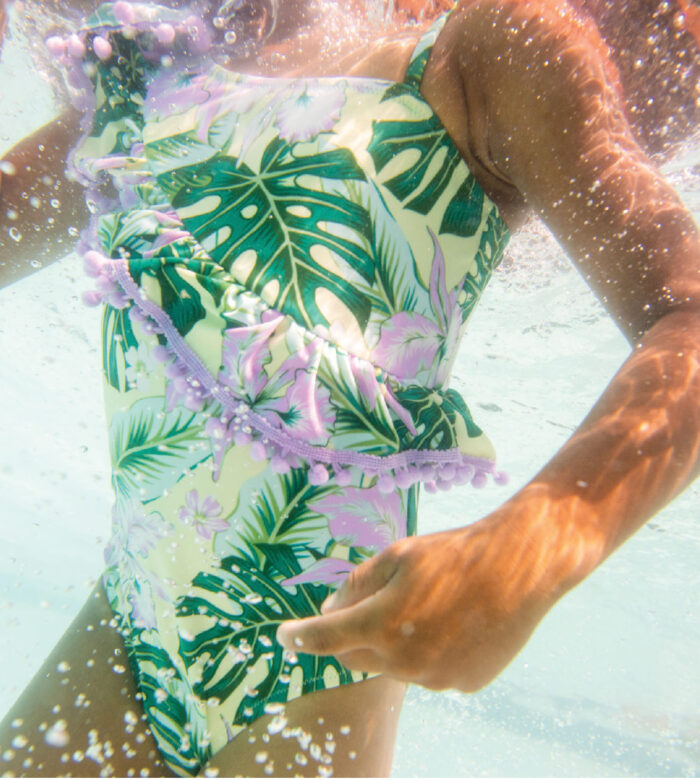 Zion wears Shade Critters tropical one-piece.