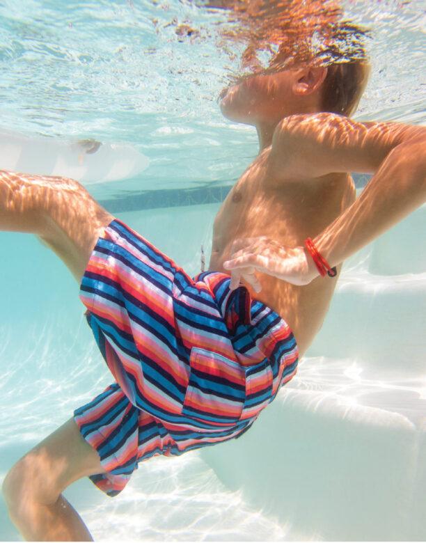 George wears Toobydoo swim trunks