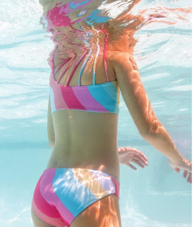 Lilly wears Feather 4 Arrow rainbow bikini.