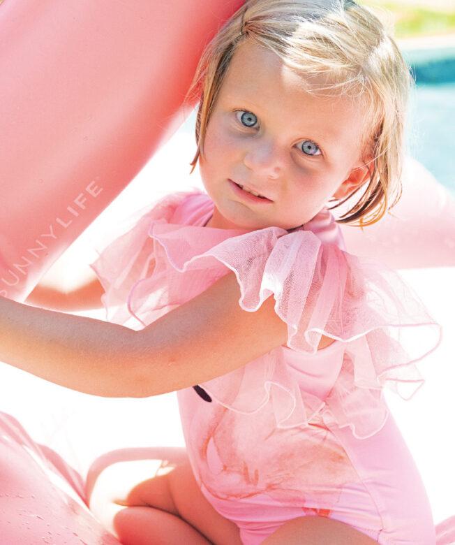 Eloise wears Shade Critters flamingo one-piece