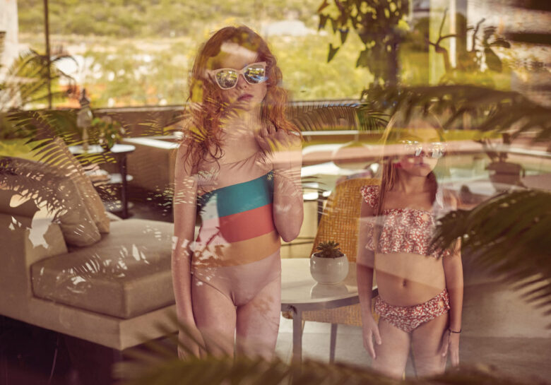 From left: Léo is wearing swimwear  by Coco Au Lait and sunglasses from  Jonas Paul Eyewear; Andy is wearing  swimwear by Mini A Ture and sunglasses from Jonas Paul Eyewear.