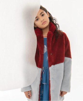 Myami wears Molo coat and unicorn dress.
