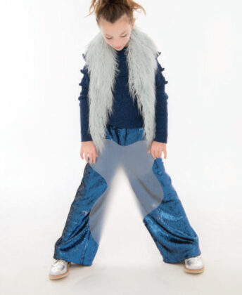 Peyton wears Widgeon light blue faux fur vest, top and sequin pants by Molo and Young Soles silver brogues.