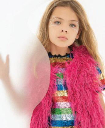 Sophia wears Hatley  faux fur vest with  Lola + the Boys dress.