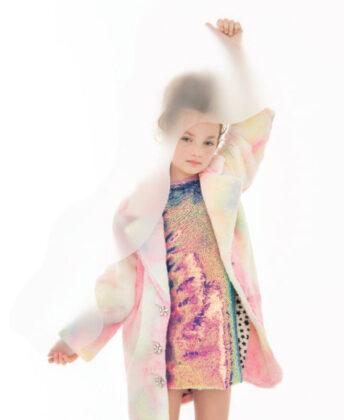 Sophia wears Bonnie Jean dress worn under Widgeon beige faux fur hooded jacket.