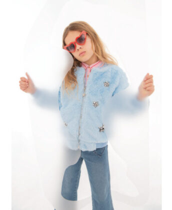 Sophia wears Lola + the Boys blue faux fur bomber and red sunglasses with Hatley striped button- down and jeans.