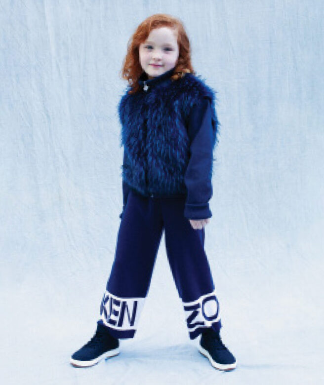 Ariana wears Kenzo pants with Appaman faux fur zip-up.