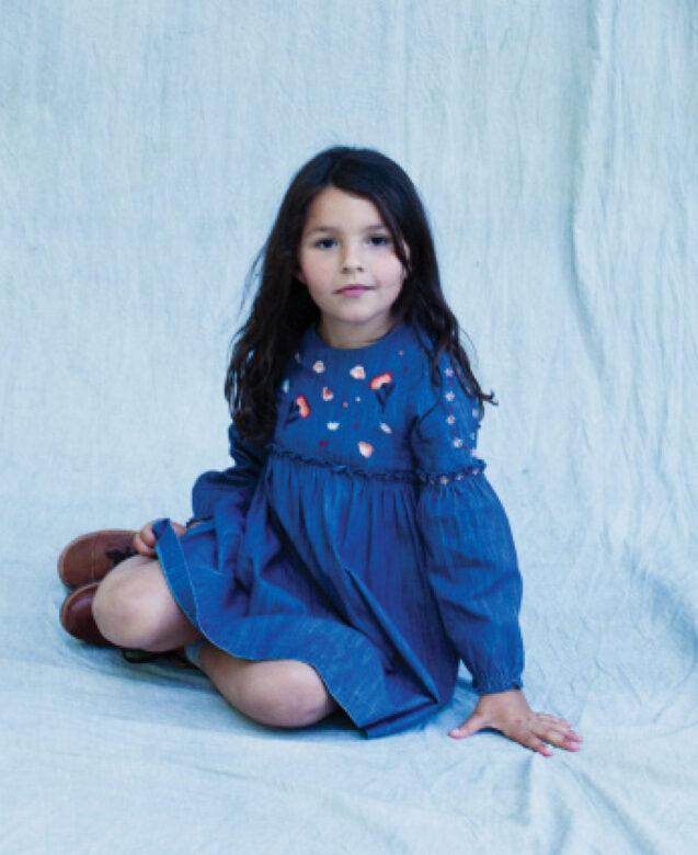 Kaya wears Tartine Au Chocolat dress with her own shoes.