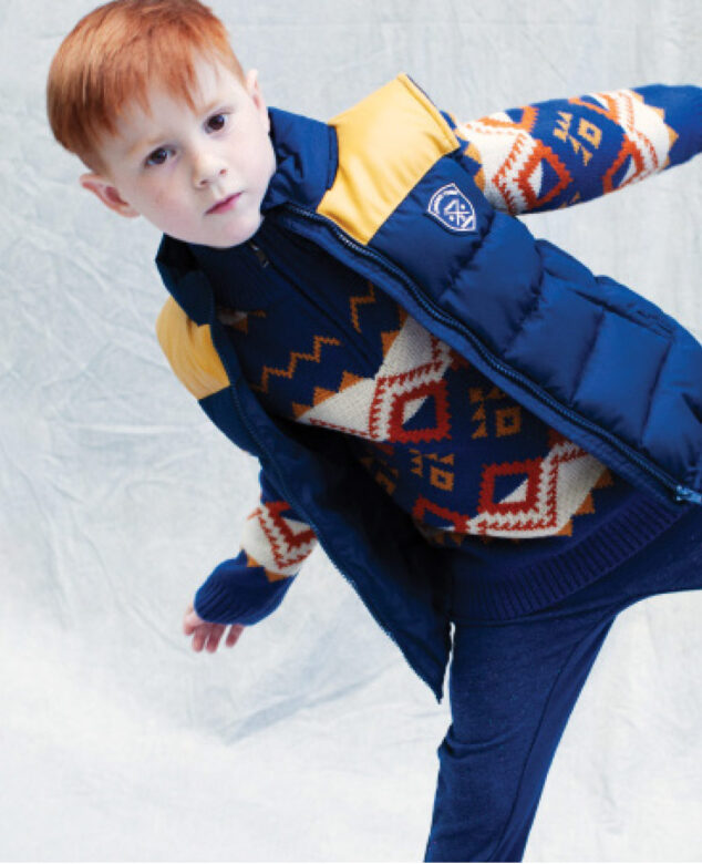 Nicholas wears 3 Pommes puffer vest and sweater with Andy & Evan pants.