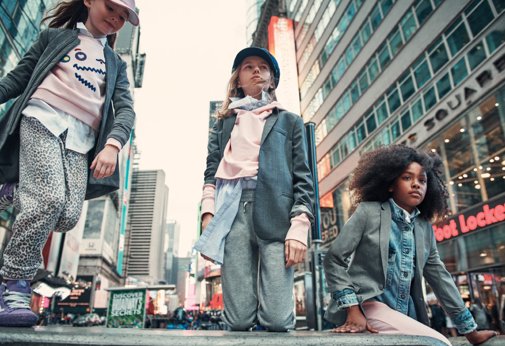(From left): Nika wears Light+Nine hat, For All Seasons jacket, button-down and sweatshirt by Lacoste, Splendid leopard print pants and Vans sneakers; Carly wears Little Lids hat, Dal Lago blazer, Yporque button-down, hoodie by Jill Yoga and Splendid pants; Jaelise wears vintage scarf, Andorine denim shirt, Appaman suit jacket and Puma joggers.