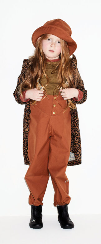 Hannah wears Faire Child overalls and hat, Joules leopard raincoat,  Kidential red and green T-shirts and Old Soles boots.