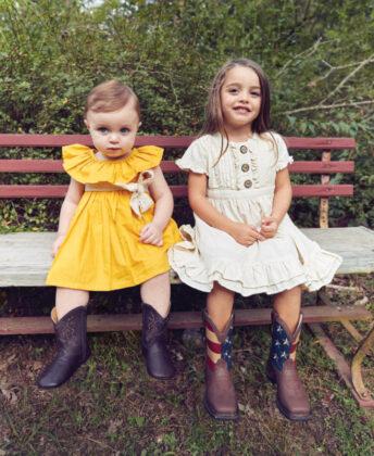 Siena wears yellow dress  by Kariu, soft-soled western boots by Nomandino and ML Kids crochet belt; Valentina wears Ren & Rouge dress   with Durango cowboy boots.