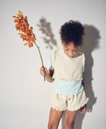 Laniya wears matching fringe top and shorts  by Yellowpelota and blue tee by Kidential.