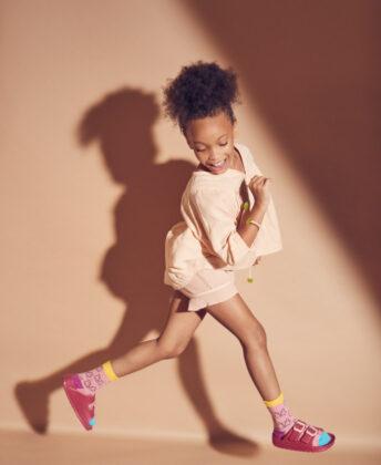 Laniya wears Chandamama blouse, Bonmot shorts, socks by Fun Socks and Joules sandals.