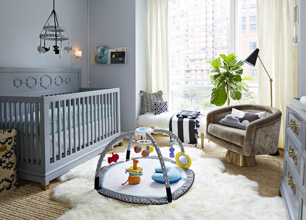 Nursery featuring several products from Fisher-Price by Jonathan Adler collection.