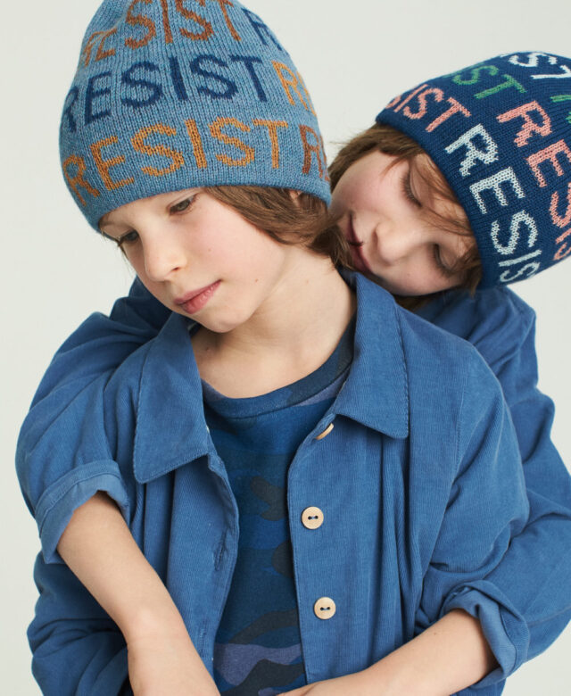 Asher wears Oeuf hat and jacket with Appaman camo shirt; Sawyer wears Oeuf hat and overalls.